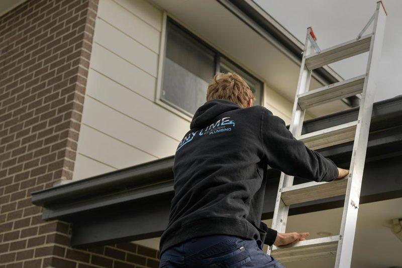 anytimemelbourne-staff-climbing-ladder